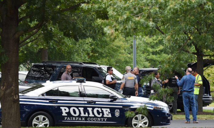 Fairfax County police and first responders at an incident in McLean, Va., on Aug. 7, 2019. (Eric BARADAT/AFP/Getty Images)