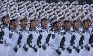 At Military Parade, Chinese Leader Xi Jinping Emphasizes Party Rule, Unifying Taiwan and Hong Kong