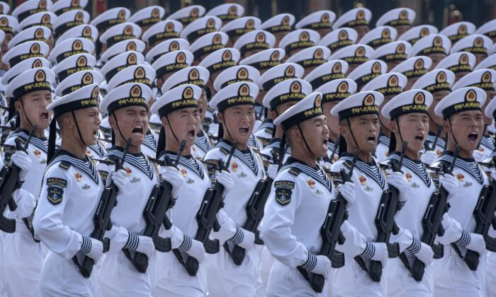 Chinese navy sailors march in formation during a parade to celebrate the 70th Anniversary of the founding of the People's Republic of China at Tiananmen Square in 1949 in Beijing, China on October 1, 2019. (Kevin Frayer/Getty Images)