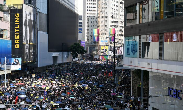 People take part in a march in the Causeway Bay shopping district in Hong Kong on Oct. 1, 2019. (Mohd Rasfan/AFP/Getty Images)