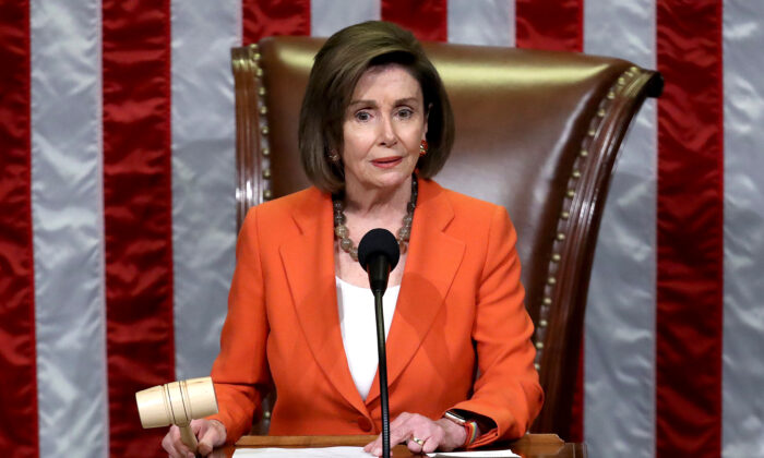 House Speaker Nancy Pelosi (D-Calif.) gavels the close of a vote by the House of Representatives on a resolution formalizing the impeachment inquiry centered on President Donald Trump in Washington on Oct. 31, 2019. (Win McNamee/Getty Images)