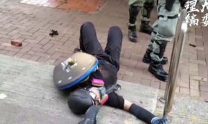 Young Protester Shot With Live Round in Hong Kong During Unrest on Chinese Regime's 70th Founding Anniversary