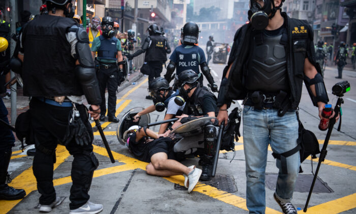Police arrest a protester during clashes in Wan Chai in Hong Kong, on Oct. 1, 2019. (Laurel Chor/Getty Images)