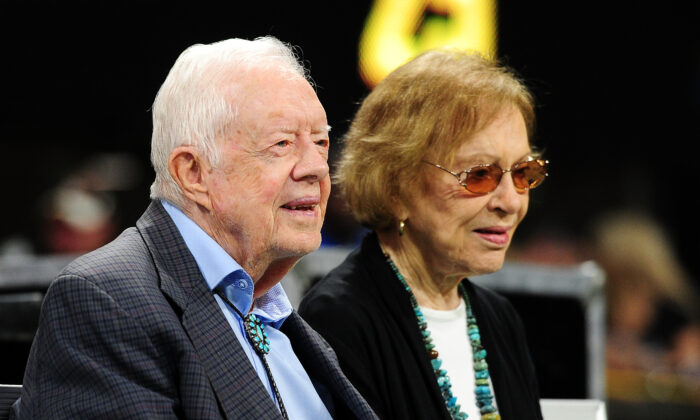 Former president Jimmy Carter and his wife Rosalynn before the game between the Atlanta Falcons and the Cincinnati Bengals at Mercedes-Benz Stadium in Atlanta, Georgia on Sept. 30, 2018. (Scott Cunningham/Getty Images)