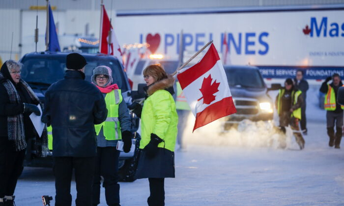 """The """"United We Roll"""" convoy of semi-trucks prepares to leave Red Deer, Alta., on Feb. 14, 2019, on its way to Ottawa to draw attention to lack of support for the energy sector and lack of pipelines. (The Canadian Press/Jeff McIntosh)"""