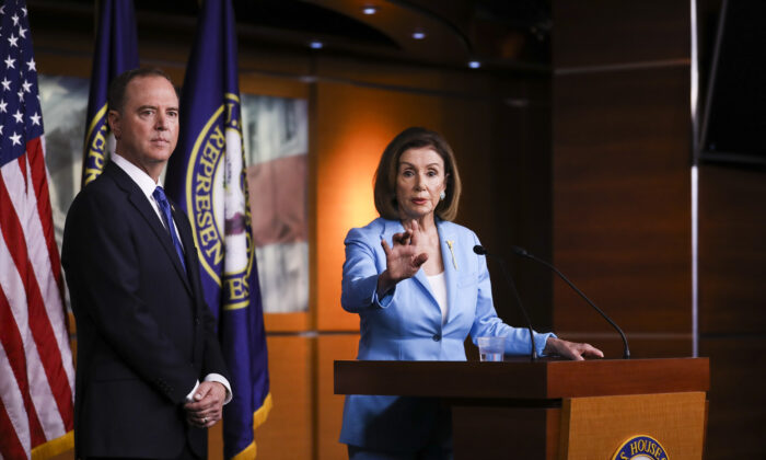 Speaker of the House Nancy Pelosi (D-Calif.) and Rep. Adam Schiff (D-Calif.), House intelligence chairman, hold a press conference about the impeachment inquiry of President Trump, at the Capitol in Washington on Oct. 2, 2019. (Charlotte Cuthbertson/The Epoch Times)