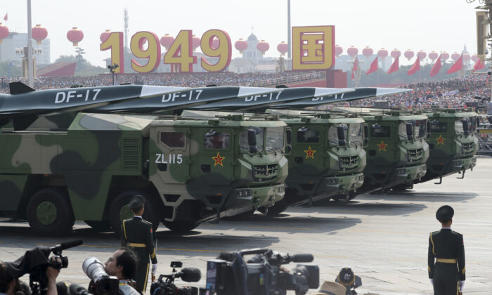 Military vehicles, carrying DF-17, roll down as members of a Chinese military honor guard march during the parade to commemorate the 70th anniversary of the founding of Communist China in Beijing on Oct. 1, 2019.  (Ng Han Guan/AP Photo)