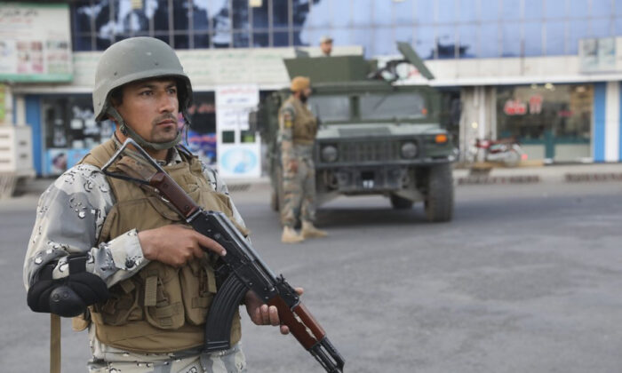 Afghan soldiers stand guard near a polling station in Kabul, Afghanistan, on Sept. 28, 2019. (Ebrahim Nooroozi/AP Photo)