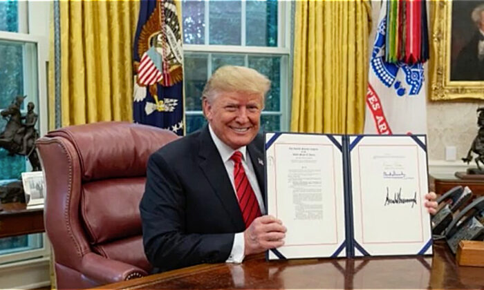 Autism research bill signed into law by President Trump. (CNN)