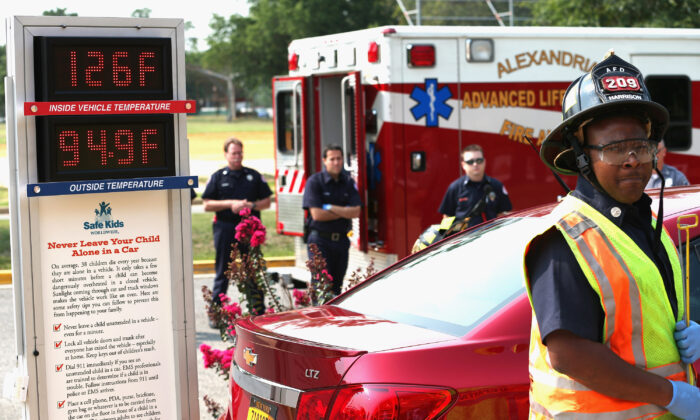 Emergency responders participate in a demonstration of the dangers of leaving children in vehicles in Virginia in a file photograph. (Chip Somodevilla/Getty Images)