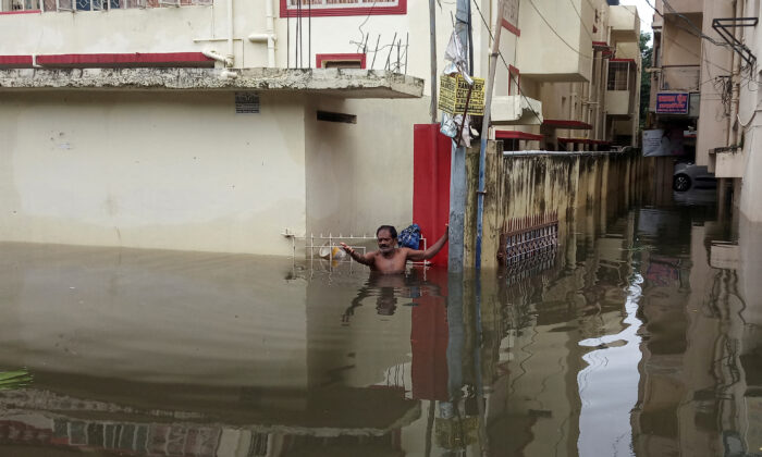 A man asks for help as he stands in the flood waters at a neighbourhood in Patna, in the eastern state of Bihar, India, Sept. 30, 2019. (Stringer/Reuters)