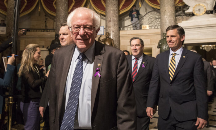Sen. Bernie Sanders (I-Vt.) in the Statuary Hall of the Capitol building on the way to attending the State of the Union in Washington on Jan. 30, 2018. (Samira Bouaou/The Epoch Times)