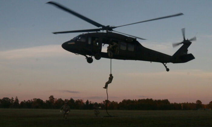 At least 22 paratroopers were injured during a night military exercise at Camp Shelby. (@GoArmyMidwest/Twitter)