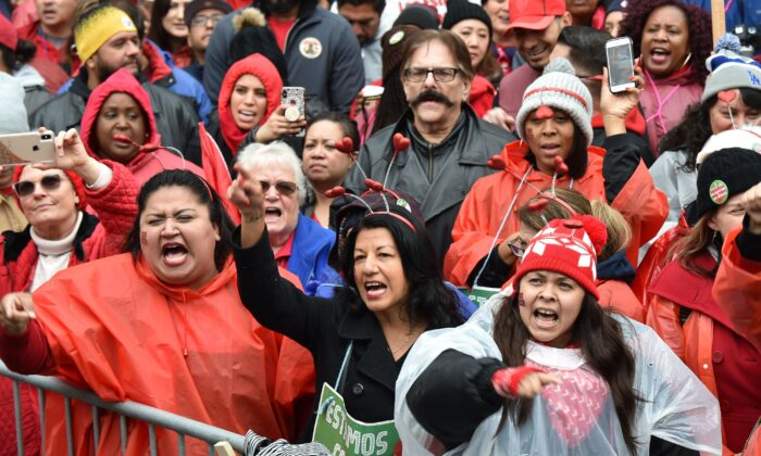 Striking teachers and their supporters rally in downtown Los Angeles, California on the second day of the teachers strike, on January 15, 2019. - Teachers of the Los Angeles Unified School District (LAUSD), the second largest public school district in the United States, are striking for smaller class size, better school funding and higher teacher pay. (Photo by Robyn Beck / AFP)        (Photo credit should read ROBYN BECK/AFP/Getty Images)
