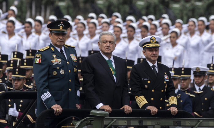 Mexican President Andres Manuel Lopez Obrador (C), Mexican Navy Secretary Jose Rafael Ojeda Duran (R) and Mexican Defence Secretary General Luis Cresencio Sandoval, take part in a parade celebrating a new anniversary of the country's independence, at the Zocalo Square in Mexico City on September 16, 2019. (Photo by PEDRO PARDO / AFP)        (Photo credit should read PEDRO PARDO/AFP/Getty Images)