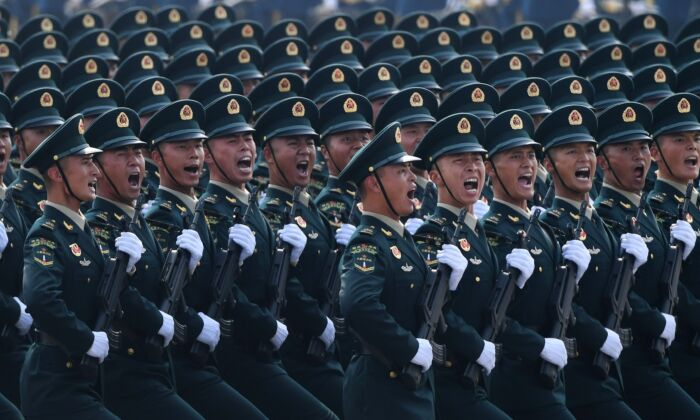 Chinese troops march during a military parade in Tiananmen Square to mark the 70th anniversary of the founding of the People's Republic of China in Beijing on October 1, 2019. (GREG BAKER/AFP/Getty Images)