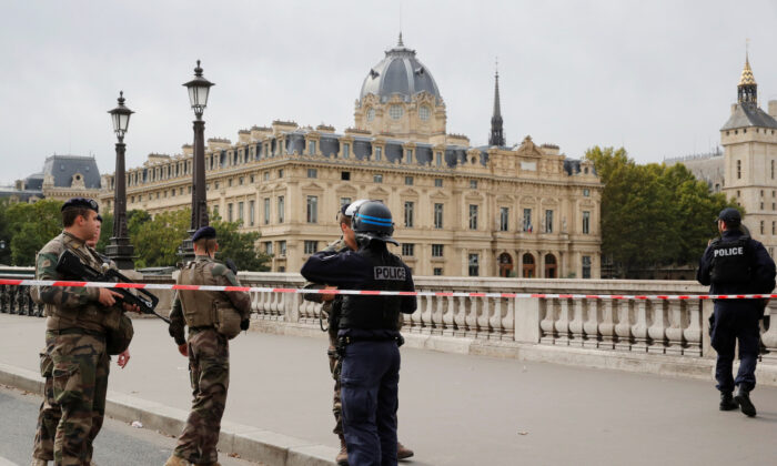 French police secure the area in front of the Paris Police headquarters in Paris, France on Oct. 3, 2019. (Philippe Wojazer/Reuters)
