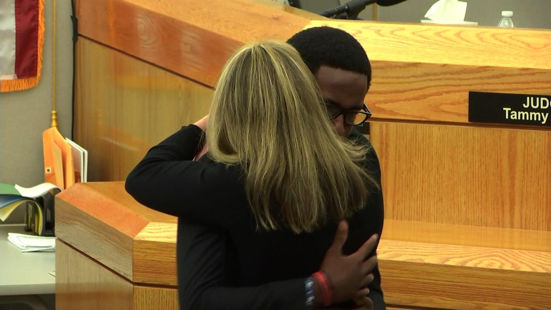 Brandt Jean hugs Amber Guyger