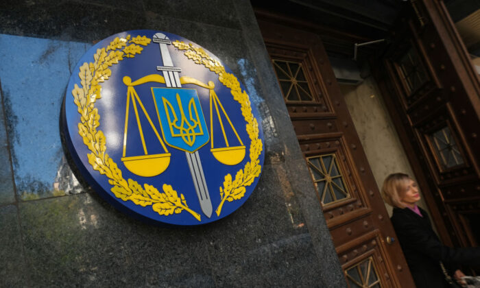 A woman leaves the offices of the Ukrainian General Prosecutor in Kiev, Ukraine, on Oct. 02, 2019. Ukraine has found itself at the core of a political storm in U.S. politics since the release of a whistleblower's complaint accusing President Donald Trump of abuse of power in requesting an investigation into Joe Biden, and Biden's son, Hunter. (Sean Gallup/Getty Images)