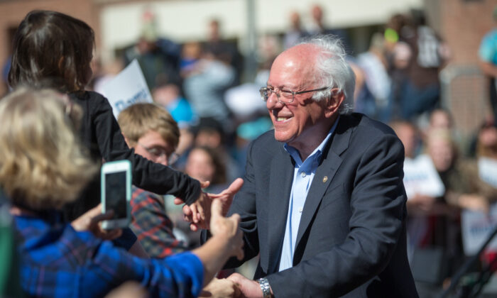 Democratic presidential candidate Sen. Bernie Sanders (I-Vt.) shakes hands with supporters following his event at Plymouth State University in Plymouth, New Hampshire, on Sept. 29, 2019. (Scott Eisen/Getty Images)