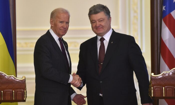 Vice President Joe Biden (L) and Ukrainian President Petro Poroshenko shake hands at the end of their joint press statement following their meeting in Kiev on Jan. 16, 2017. (Genya Savilov/AFP/Getty Images)