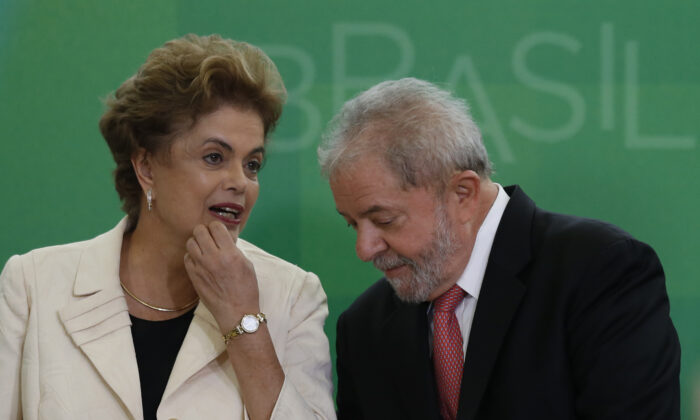 Brazil's former president, Luiz Inacio Lula da Silva talks with then-Brazil President Dilma Rousseff as he is sworn in as the new chief of staff in the Planalto Palace on March 17, 2016, in Brasilia, Brazil. (Igo Estrela/Getty Images)