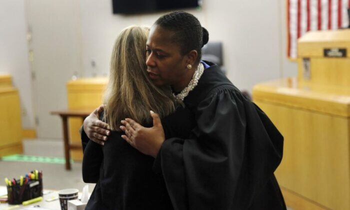 State District Judge Tammy Kemp gives former Dallas Police Officer Amber Guyger a hug before Guyger leaves for jail in Dallas on Oct. 2, 2019. (Tom Fox/The Dallas Morning News via AP, Pool)