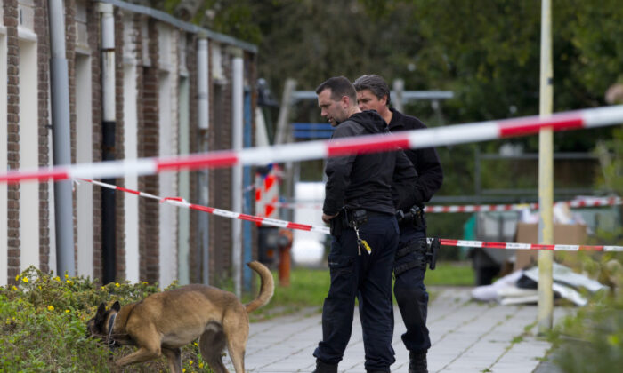 Forensic experts search for evidence in the area where a lawyer who represented a key witness in a major Dutch organized crime trial was gunned down in Amsterdam, in Amsterdam, Netherlands on Sept. 18, 2019. (Peter Dejong/AP)