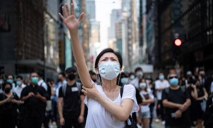 People protest a government ban on face masks in Central, Hong Kong, on Oct. 4, 2019. (Laurel Chor/Getty Images)
