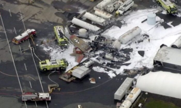 In this aerial image taken from video, emergency crews respond to where a World War II-era bomber B-17 plane crashed at Bradley International Airport in Windsor Locks, Conn., on Oct. 2, 2019. (WFXT Boston 25 News via AP)