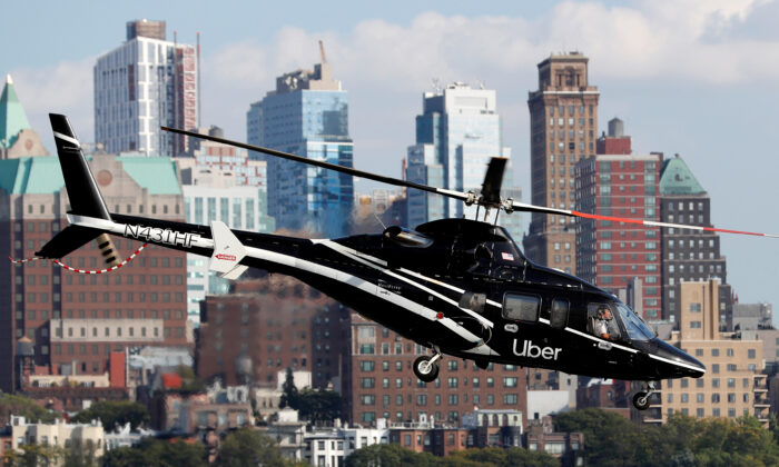 A helicopter operated by Uber Copter, a new service by the ride-sharing company Uber, providing service from Manhattan to New York's JFK International Airport initially for Diamond and Platinum Uber Rewards members as well as special Uber partners takes off from Manhattan, New York, U.S., Oct. 2, 2019. (Mike Segar/Reuters)
