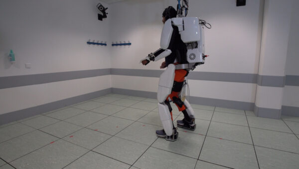 A patient with tetraplegia walks using an exoskeleton in Grenoble