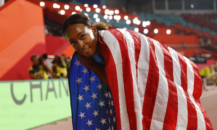 Dalilah Muhammad of the U.S. celebrates after winning gold and breaking the world record at the Khalifa International Stadium, Doha, Qatar on Oct. 4, 2019. (Kai Pfaffenbach/Reuters)