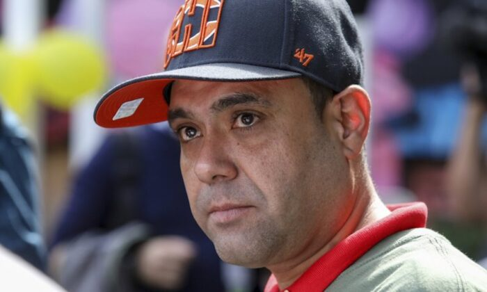 Miguel Perez Jr. listens to a supporter speaking at a news conference in Chicago on Sept. 24, 2019. (Teresa Crawford/AP Photo)