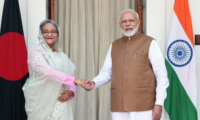 India's Prime Minister Narendra Modi (R) shakes hands with Bangladesh's Prime Minister Sheikh Hasina prior to a meeting in New Delhi on Oct. 5, 2019. (Prakash Singh/AFP via Getty Images)