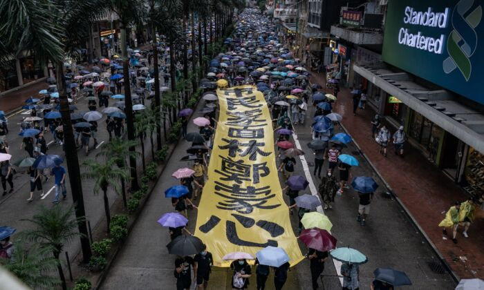 Pro-democracy protesters take part in a demonstration as they march on a street in Hong Kong, China on Oct. 6, 2019. (Anthony Kwan/Getty Images)