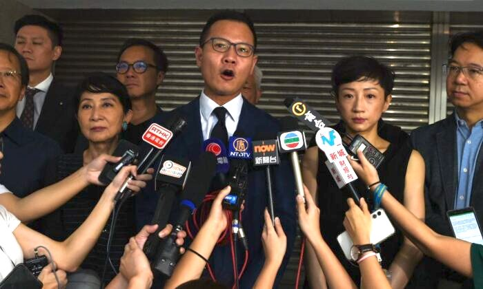 Lawmaker Dennis Kwok speaks to journalists outside the High Court as he and some 23 other lawmakers seek an emergency injunction in a bid to overturn a face mask ban in Hong Kong on Oct. 6, 2019. (Mohd Rasfan/AFP via Getty Images)