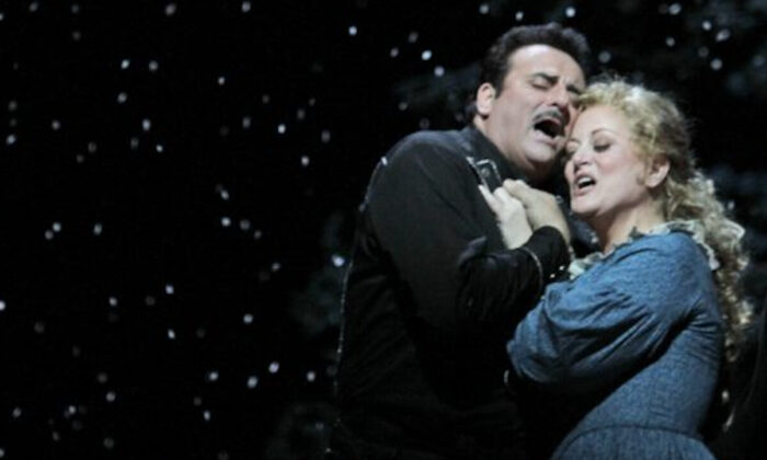 """Marcello Giordani (L) performs as Ramerrez alongside Deborah Voigt performing as Minnie during the final dress rehearsal of Giacomo Puccini's """"La Fanciulla del West,"""" at the Metropolitan Opera in New York City on Dec. 3, 2010. (Mary Altaffer/AP Photo)"""