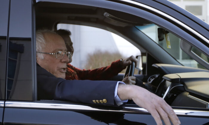 Democratic presidential candidate Sen. Bernie Sanders (I-Vt.) departs Burlington International Airport and head home after being treated for a heart attack, on Oct. 5, 2019. (Steven Senne/AP Photo)