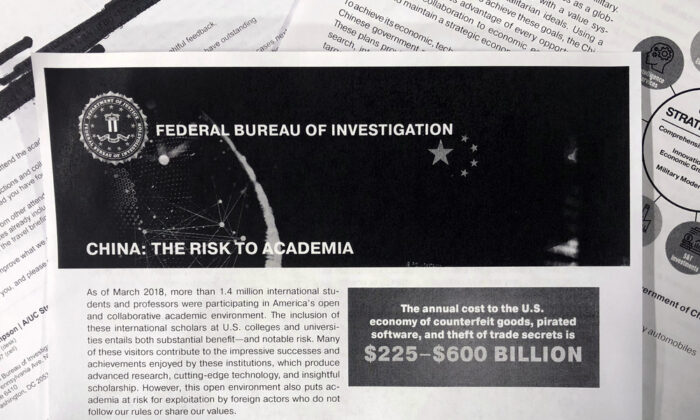 This Oct. 4, 2019, photo shows a copy of an FBI pamphlet and related emails. (AP Photo)