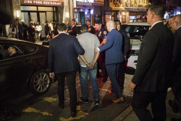 Police officers escort Randy Rodriguez Santos