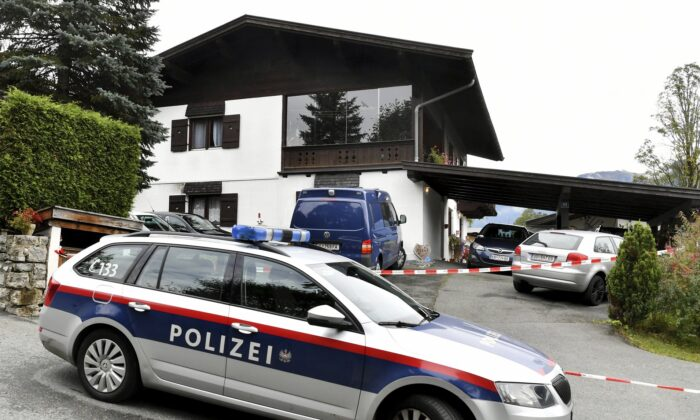 A police car is parked in front of a house in Kitzbühel, Austria, on Oct. 6, 2019. (Kerstin Joensson/AP Photo)