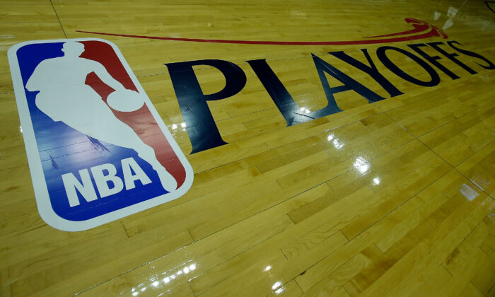 A Playoffs logo is seen on the court before the game between the Oklahoma City Thunder and Houston Rockets in Game Three of the Western Conference Quarterfinals of the 2013 NBA Playoffs at the Toyota Center in Houston, Texas on April 27, 2013. (Scott Halleran/Getty Images)