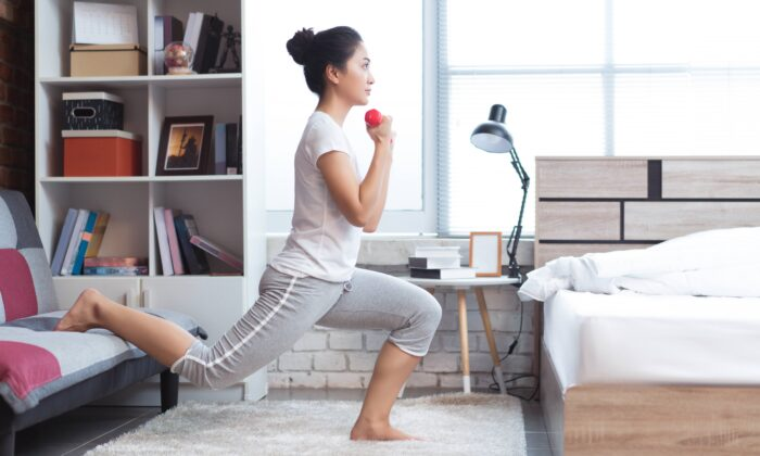 A bedside gym can be as simple as a yoga mat and a couple weights. (TORWAISTUDIO/Shutterstock)
