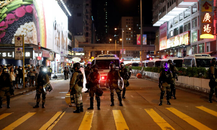 Riot police officers patrol streets as pro-democracy protesters gather in Mong Kok district, Hong Kong, China on Oct. 7, 2019. (Jorge Silva/Reuters)