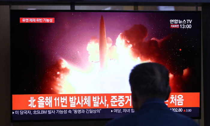People watch a TV showing a file image of a North Korean missile launch at the Seoul Railway Station on Oct. 2, 2019 in Seoul, South Korea. North Korea fired what was believed to be a submarine-launched ballistic missile (SLBM) from waters off its east coast, South Korea's military said, demonstrating its nuclear delivery capabilities just days before resuming denuclearization talks with the United States. (Chung Sung-Jun/Getty Images)