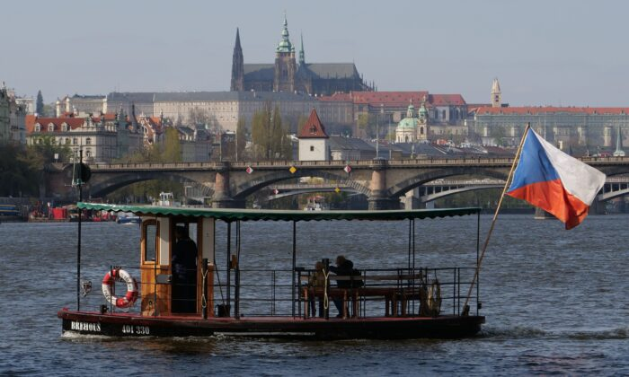 A river ferry sails at the Vltava river connecting two sides of the city and one of the islands in Prague, Czech Republic, on April 11, 2019. (Joe Klamar/AFP/Getty Images)