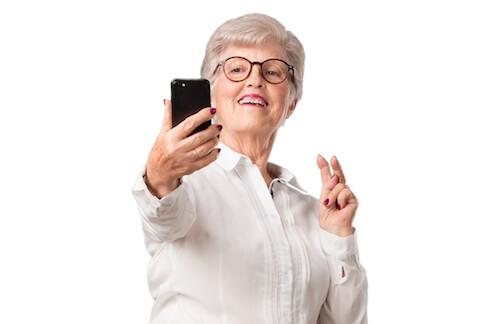 senior woman taking a selfie