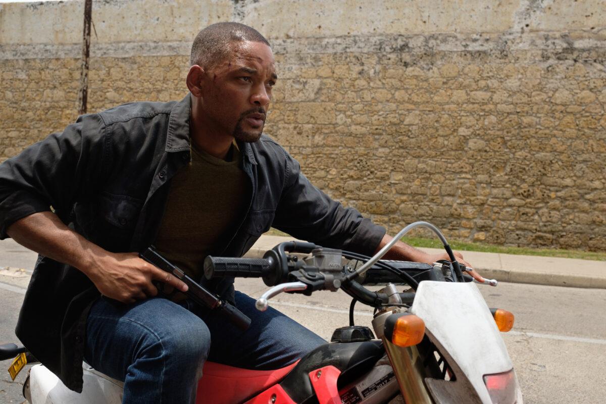 man on motorcycle with gun