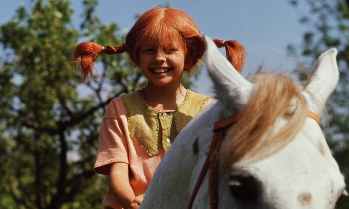 """A still from the movie """"Pippi Longstocking"""" with Inger Nilsson as Pippi on her horse, Little Gubben, in a file photo taken in May 1969. (Pressens Bild/AFP/Getty Images)"""